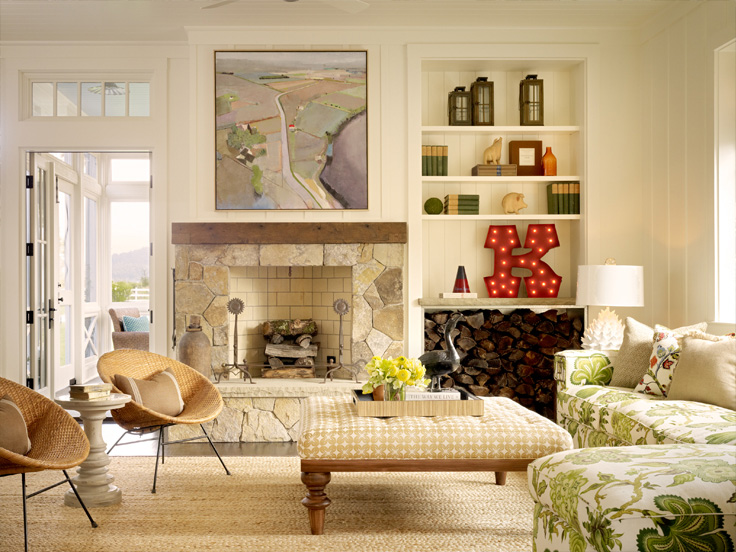 Colorful living room with fireplace and bold prints in Napa Valley farmhouse by Ken Fulk in C Magazine