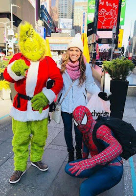 Whitney Bates with the Grinch and Spider-Man