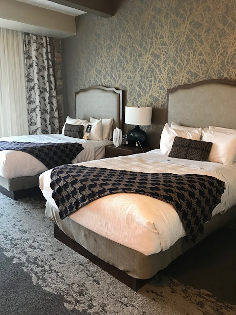 Hotel room of two queen bed at the Lodge of the 4 Seasons