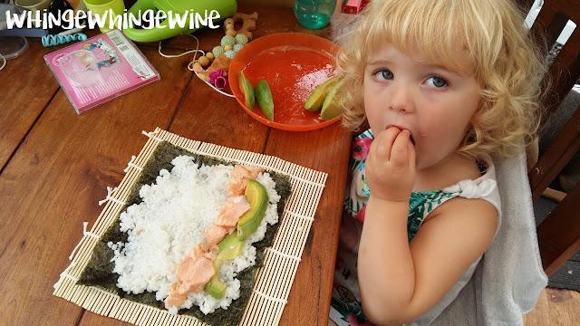 Toddler making sushi