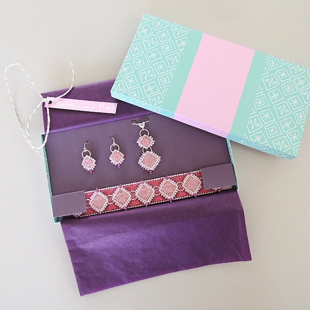 hand stitched bracelet, necklace and earrings in display gift box