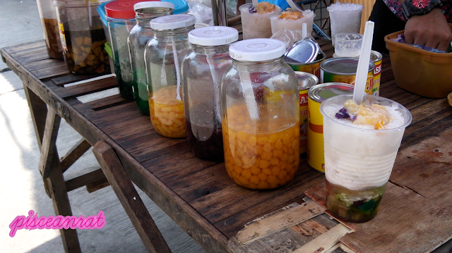 Halo-halo- shaved ice, milk, sugar, leche flan, ube, sago, gulaman, banana, monggo, beans, langka, etc. There are variations depending on the seller.