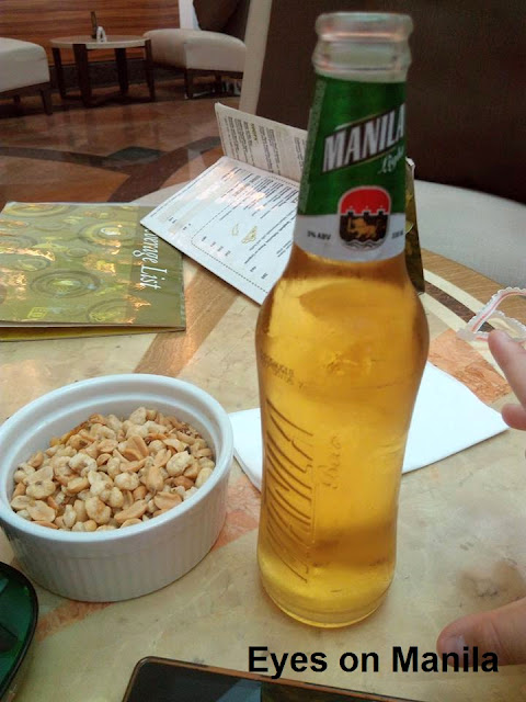 Manila Beer for hubby with complimentary nuts on the side