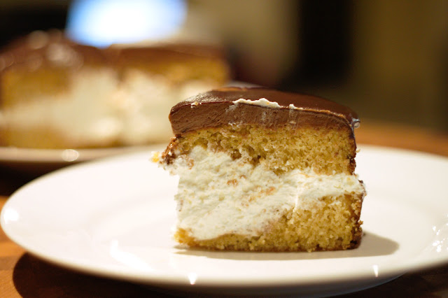 Slice of layered hot milk cake with creme chantilly filling