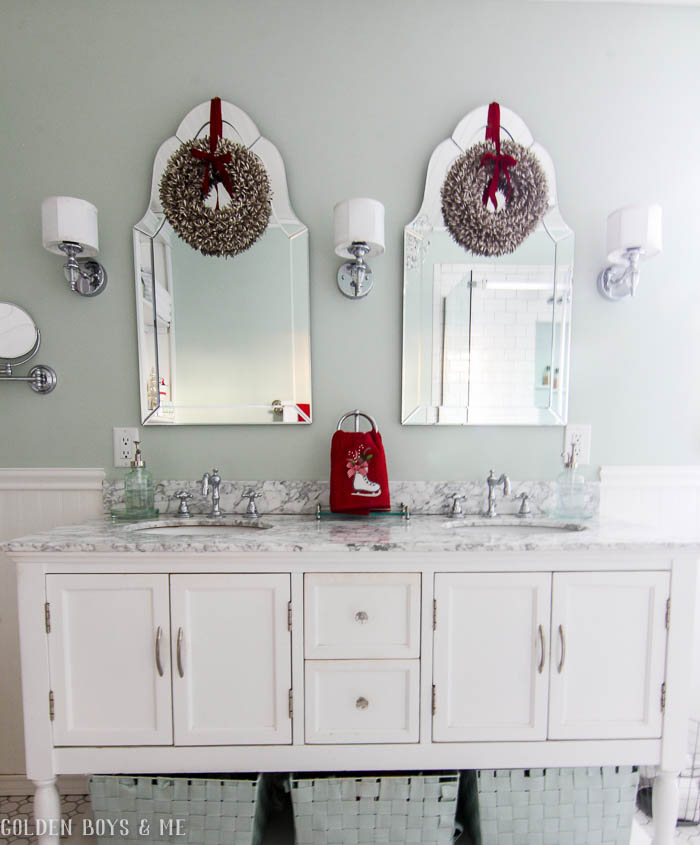 Christmas decor in master bathroom with built ins, bead board and Sherwin Williams sea salt paint