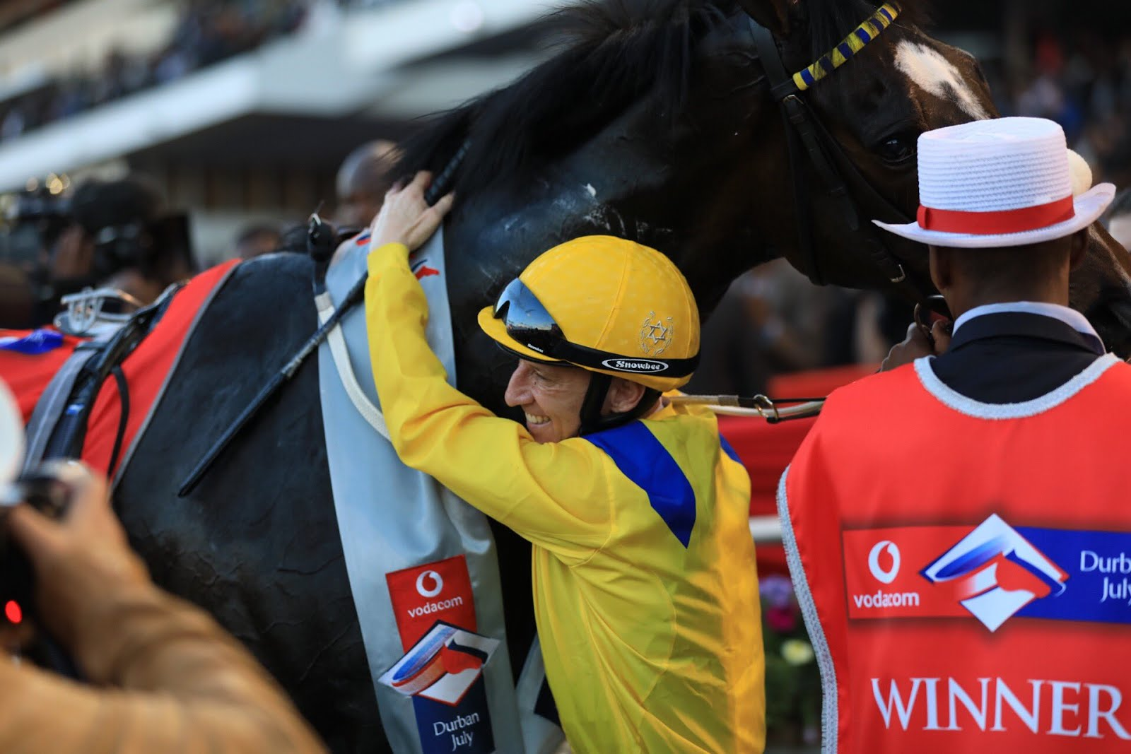 Anton Marcus hugging the horse Do It Again after winning the Vodacom Durban July 2018