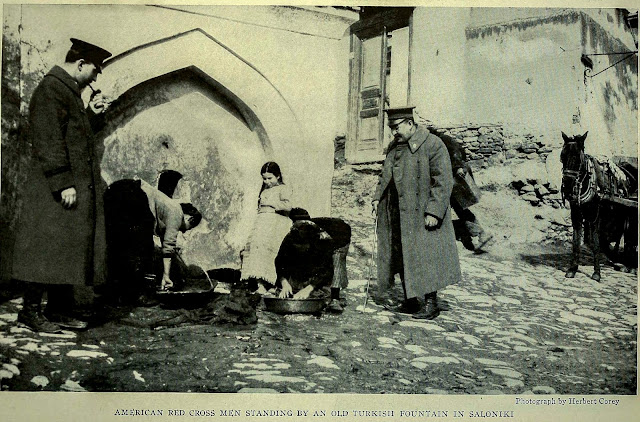 AMERICAN RED CROSS MEN STANDING BY AN OLD TURKISH FOUNTAIN IN SALONIKI