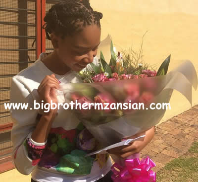 former big brother mzansi housemate blue mbombo with k2 flowers