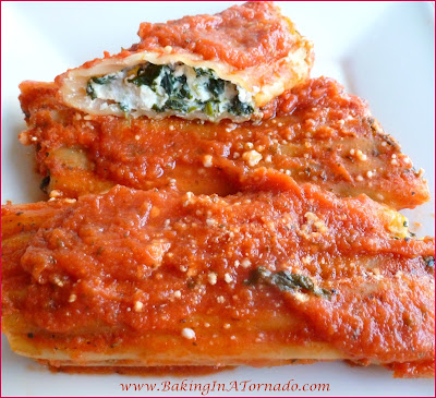 Meatless Manicotti: A hot bubbling dish for a cold fall or winter night. This meal is so hearty and filling you won't even miss the meat. Serve with Garlic Bread and a salad and dinner is complete. | Recipe developed by www.BakingInATornado.com | #recipe #dinner