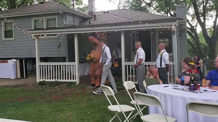 Maid Of Honor Dressed Up As A T-Rex At Her Sister's Wedding