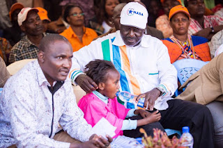 Raila Odinga gives water to a child in Meru. PHOTO | Courtesy