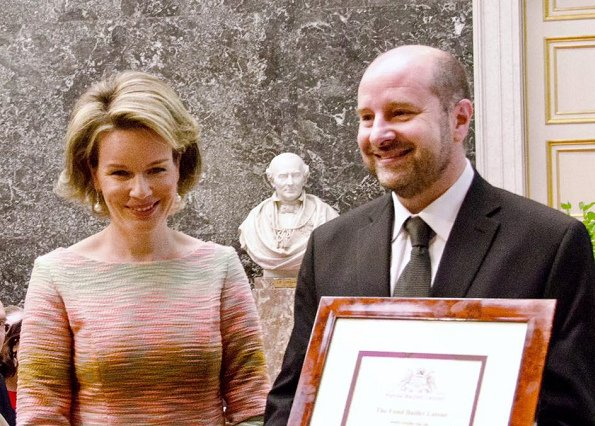 Queen Mathilde was glowing in a bold, form-fitting pastel-hued dress, she wore with a pair of classic nude heels, as she arrived at the Baillet Latour Health Prize ceremony