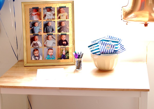 Monthly baby photo collage sits on a party table.