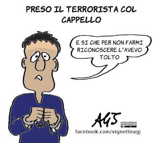 abrini, terrorista col cappello, belgio, travestimenti, vignetta, satira
