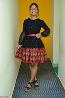 Aditi Myakal in Spicy Red Short Skirt and Transparent Black Top at at Big FM For Promotion of Movie Ami Tumi 001.JPG