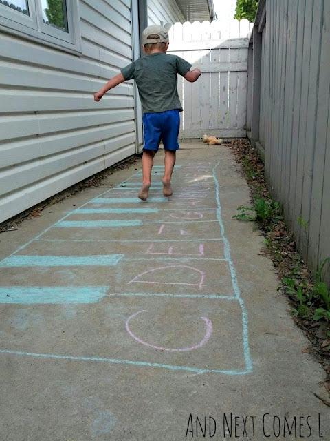 Child jumping on a chalk keyboard
