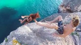 Selfish boyfriend pulls leg away as his girlfriend falls off a cliff