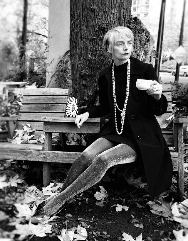 Mel Kobayashi of Bag and a Beret in pearls, enjoying her tea in the garden