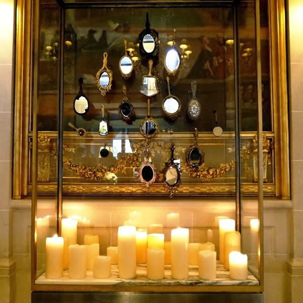 Le Meurice Hotel reception candle and mirror display in Paris