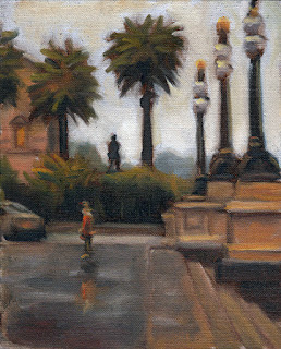 Oil painting of a figure standing on a wet paved area with lamp posts and steps to the right and the silhouette of a statue and palm trees behind.