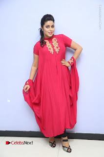 Actress Poorna Latest Stills in Red Dress at Rakshasi First Look Launch  0357.JPG