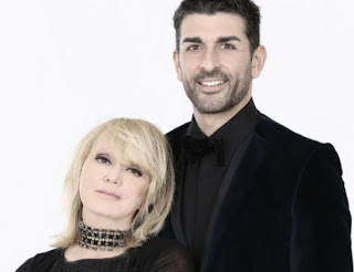 Rita Pavone with dance partner Simone di Pasquale in a publicity shot for the TV show Ballando Con le Stelle