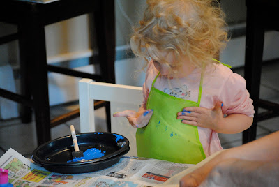 Little girl with apron on