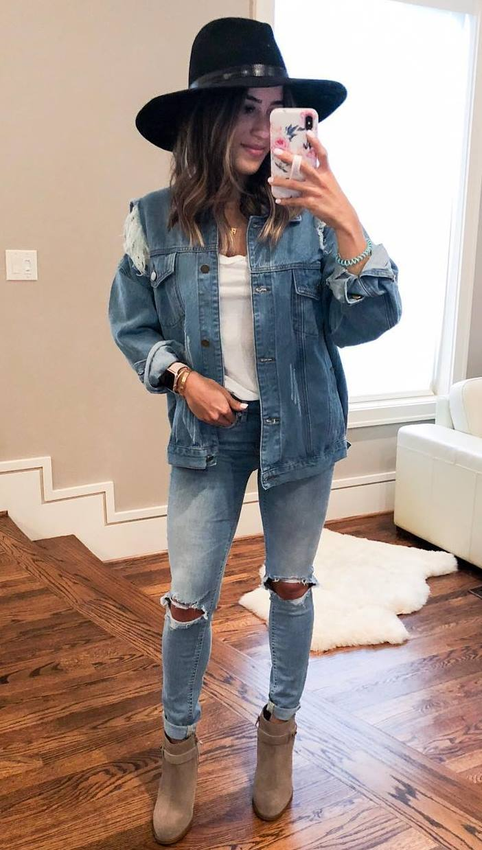great denim outfit to try this fall : jacket + hat + boots + white top + ripped jeans