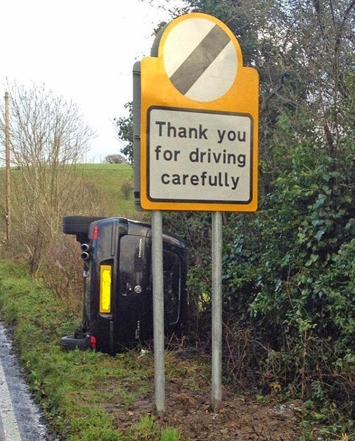 car crashed by safety sign funny