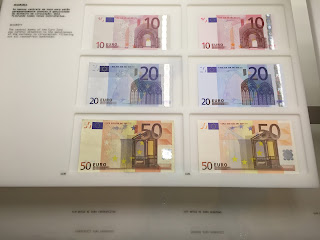 Counterfeit and authentic Euro bills