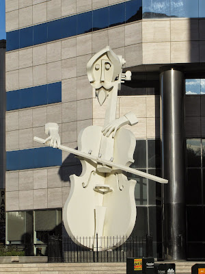 Virtuoso - sculpture of giant cello player  by David Adickes