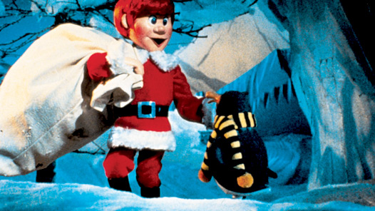 Kris delivering presents in Santa Claus is Comin' to Town 1970 animatedfilmreviews.blogspot.com