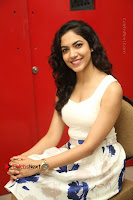 Actress Ritu Varma Stills in White Floral Short Dress at Kesava Movie Success Meet .COM 0203.JPG