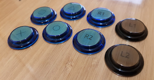 The Flat-Stick - Laser-etched button inserts