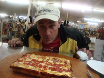 Lol, my friend Dave staring at a Detroit style pizza I made