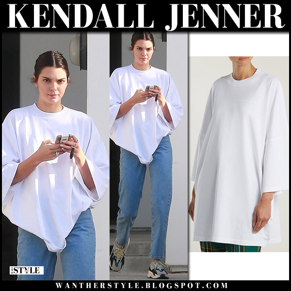 Kendall Jenner in white oversized t-shirt, jeans and sneakers model street fashion june 2018