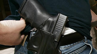 Oklahoma school personnel with valid handgun licenses could carry on campus
