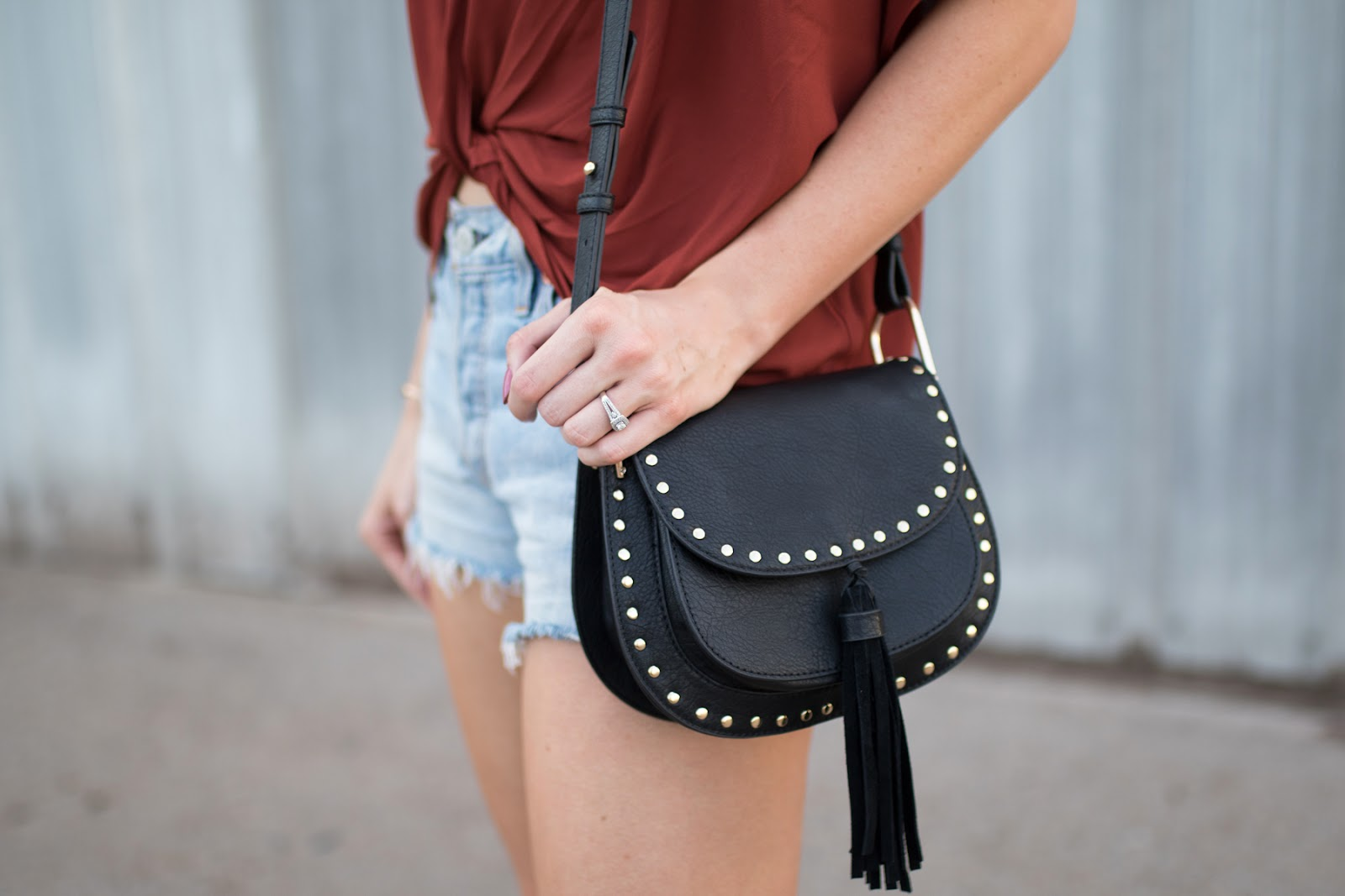 Studded canteed-style bag with tassle