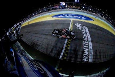 Darrell Wallace Jr., driver of the #54 ToyotaCare Toyota, takes the checkered flag to win the NASCAR Camping World Truck Series Ford EcoBoost 200 at Homestead-Miami Speedway on November 14, 2014 in Homestead, Florida.