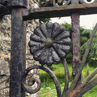 Flower detail on a gate in the gardens at Tapeley