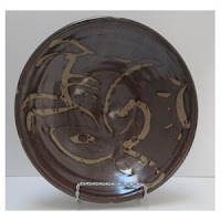 Brown Pottery Bowl Inside view-reruns slide-300 x 300jpg