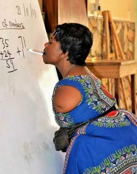 Woman Without Arms Teaching Mathematics & Writing With Her Mouth Goes Viral