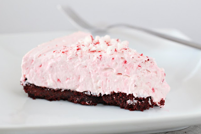 slice of no bake candy cane pie ready to eat