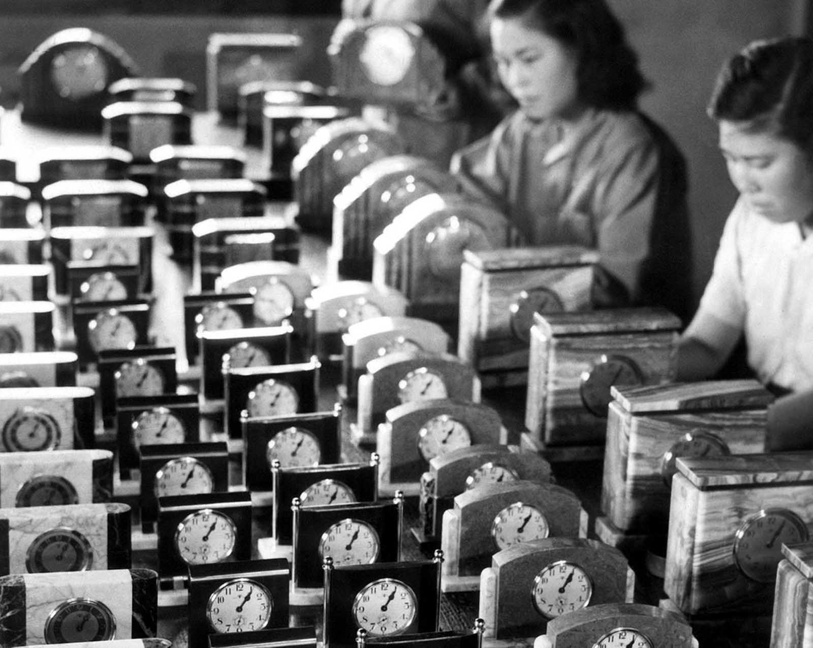 Clocks are being readied for export to Allied countries, shown as collateral for imported goods needed by Japan. Thirty-four Japanese factories produced 123,000 clocks during April of 1946. Photo taken on June 25, 1946.
