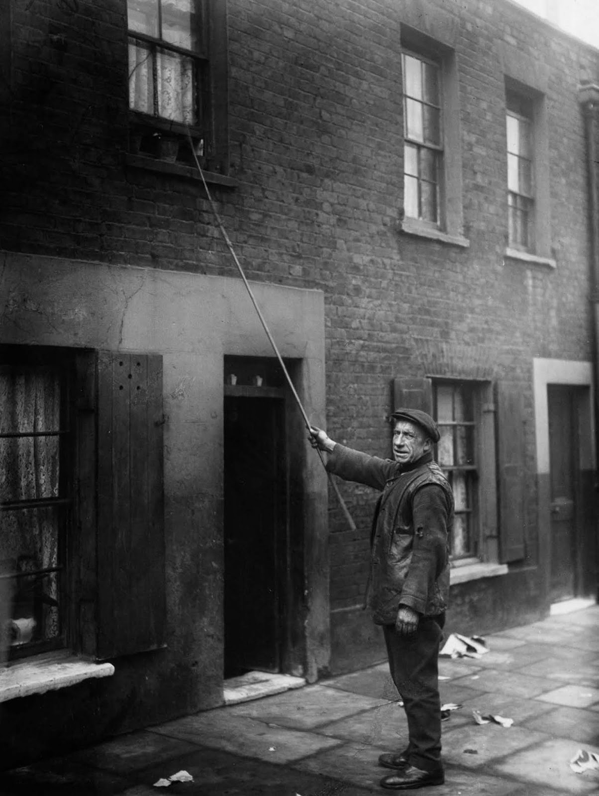 Charles Nelson of East London worked as a knocker-up for 25 years. He woke up early morning workers such as doctors, market traders and drivers. 1929.