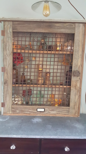 wall curio cabinet with label