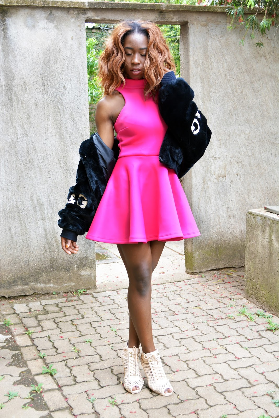on Wednesday we wear pink, breast caner awareness, how to style a pink skater dress, pink skater dress, Kenyan fashion blogger, African fashion blogger, Ezil, how to wear a fur coat, what to wear during the cold season.