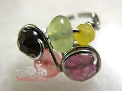 Wire wrapped fruity ring with various gemstones