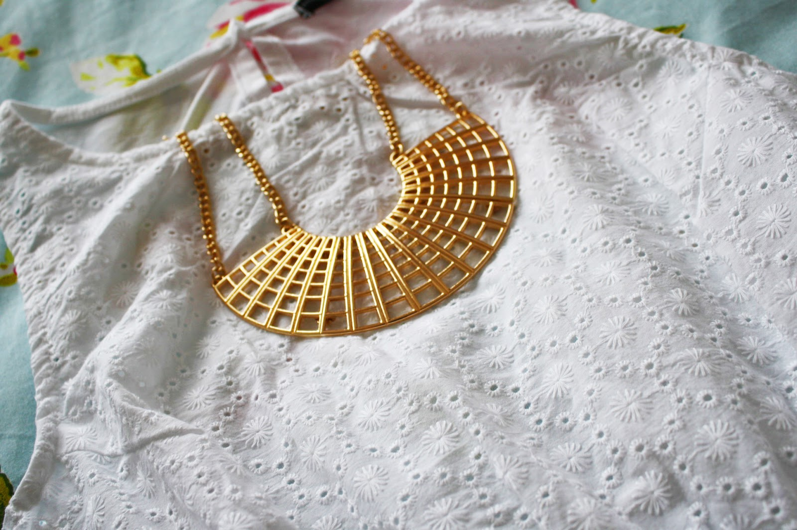 A floaty White Primark dress with Gold Primark accessories