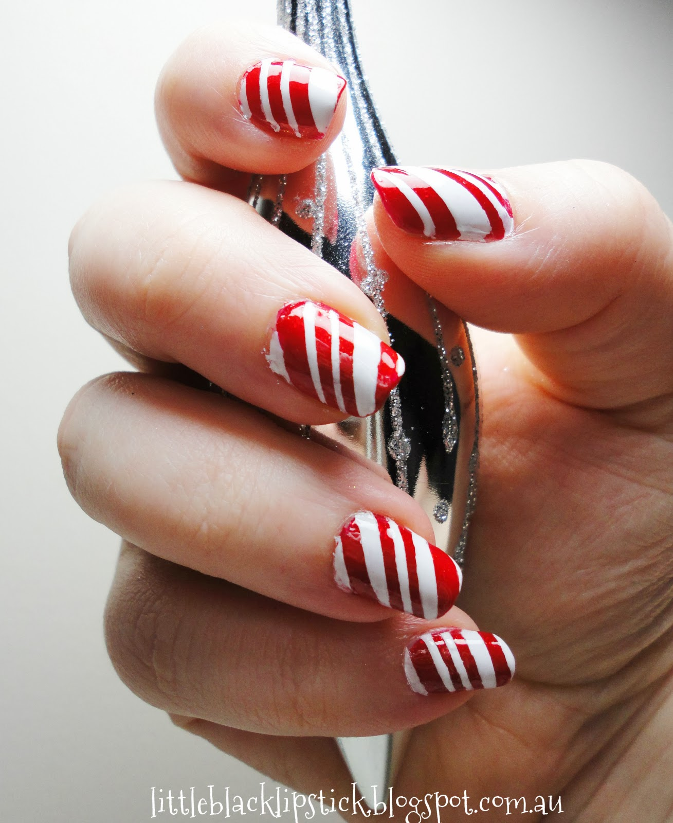 Holiday Nail Art Tutorials: Little Black Lipstick: Easy Candy Cane Christmas Nail Art